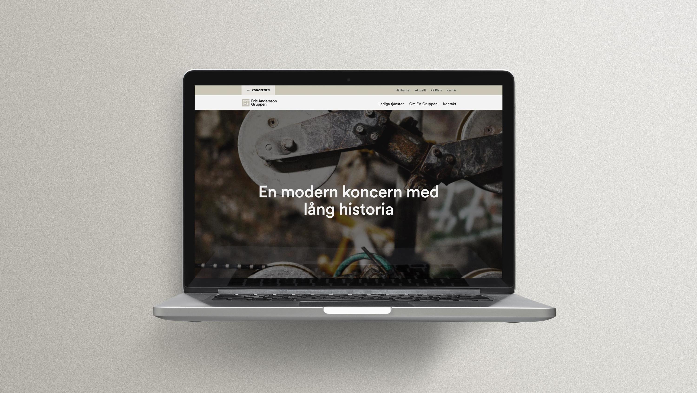 EA-gruppen ny webb. Laptop med startsida.